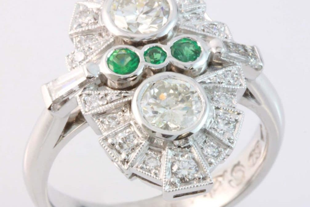 Hand crafted emerald and diamond ring