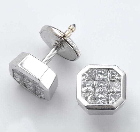 Invisible set' diamond studs in 18 carat white gold.