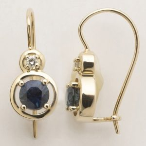Australian sapphire and diamond 'halo' earrings in 9 carat yellow gold.