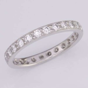 Platinum full circle diamond wedding ring with a mille grained edge