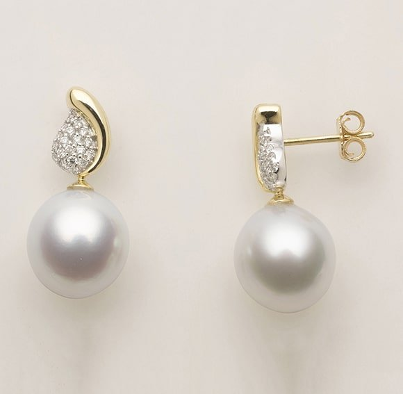 18 carat white and yellow gold pavé set diamond 'leaf' shaped studs with suspended pearl drops.
