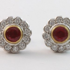 18 carat two tone ruby and diamond halo stud earrings