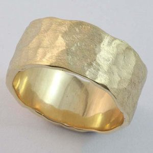 Gents solid 'beaten finish' wedding ring in 18 carat yellow gold