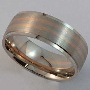 White and rose gold wedding ring with brushed finish detail