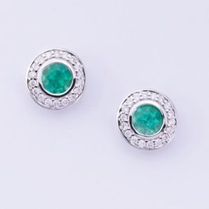 18 carat white gold emerald and diamond stud earrings.