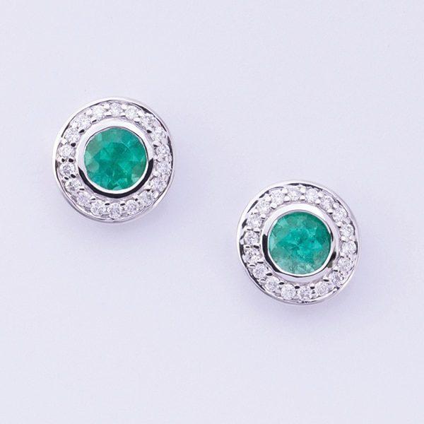 18 carat white gold emerald and diamond stud earrings.