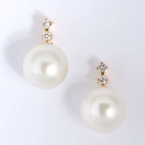 18 carat yellow gold South Sea pearl and diamond stud earrings.