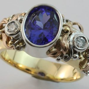 Tanzanite and diamond ring, oval Tanzanite ring, hand made Tanzanite ring, Abrecht Bird, Abrecht Bird Jewellers