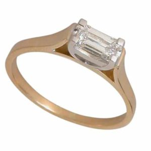 Emerald cut diamond ring in 18 carat yellow and white gold.