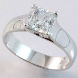 Platinum solitaire princess cut diamond ring.