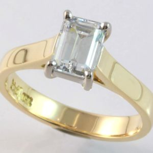 18 carat yellow and white gold solitaire emerald cut diamond ring.