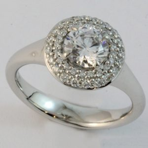 Claw set halo diamond cluster ring, set with a 1ct diamond centre.