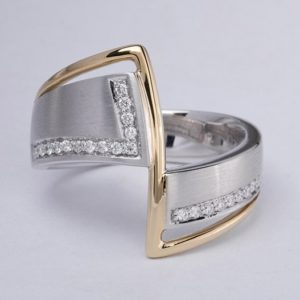 White and yellow gold diamond ring.