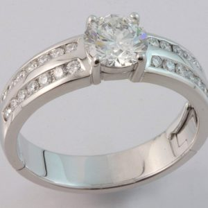 18 carat white gold channel set diamond hinged ring with 1.54ct centre.
