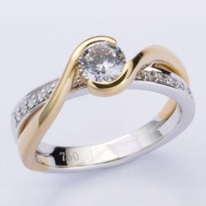 18 carat yellow and white gold diamond ring with wrap around shoulders.
