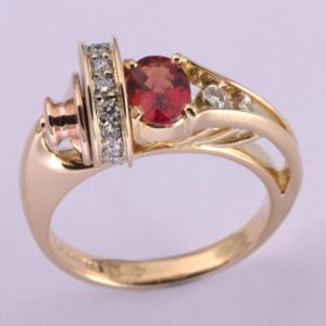 Abrecht Bird, Abrecht Bird Jewellers, red sapphire ring, orange sapphire ring, oval orange sapphire, orange sapphire, custom made sapphire ring, hand made ring, unique ring designs, spinning jewellery, Jarrad McErlain, custom made unique jewellery, Melbourne jewellers