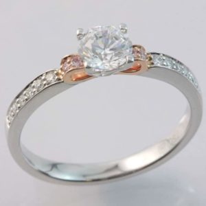 18 carat white and rose gold pink and white diamond ring.