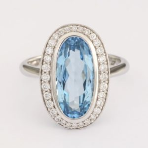Oval topaz ring, halo topaz ring, topaz and diamond ring