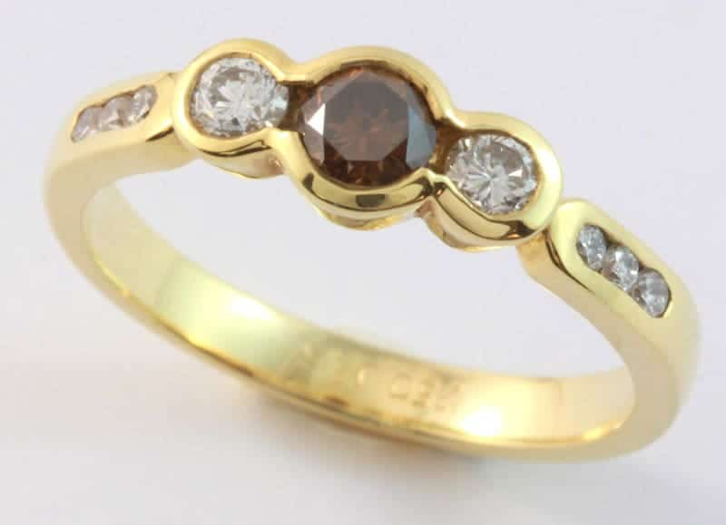 cognac diamond ring, diamond three stone ring, round cognac diamond, yellow gold diamond ring, three stone ring, Abrecht Birdm,