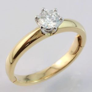 18 carat yellow and white gold brilliant cut diamond solitaire ring with hinge fitting.