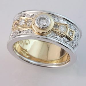 18 carat yellow and white gold multi diamond ring.