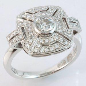 18 carat white gold multi diamond ring. Art Deco inspired.
