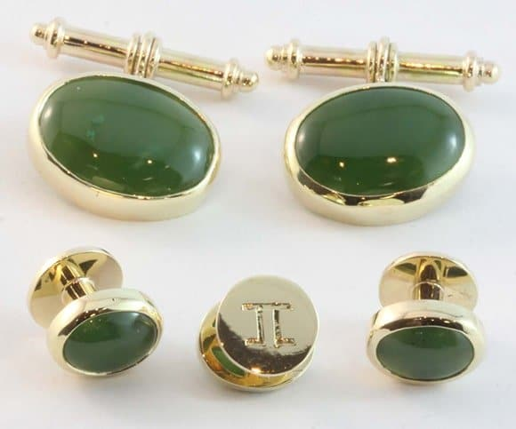 Matching cufflinks and dress studs made from yellow gold and jade