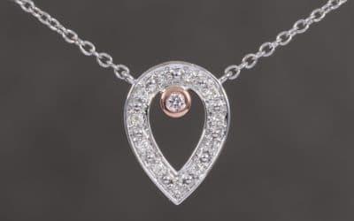 120297 : Two Tone Pear Shaped Pink & White Diamond Pendant