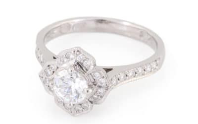120308 : 18 Carat White Gold Diamond Halo Ring